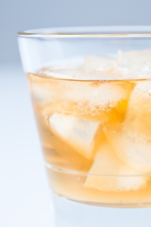 Close-up of a glass of cold drink with ice photo