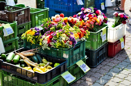 Crates of vegetables and flowers at the farm fair in Prague photo