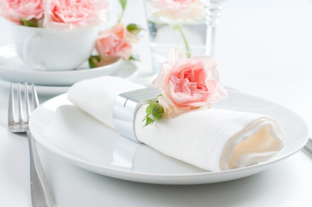 wedding table decor: Holiday romantic table setting with pink roses on a white background