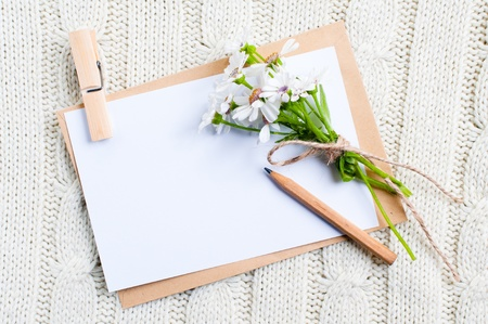 Empty cardboard card with flowers and an envelope photo