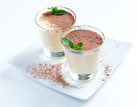 eggnog: Two creamy vanilla desserts with cocoa and mint leaf Stock Photo