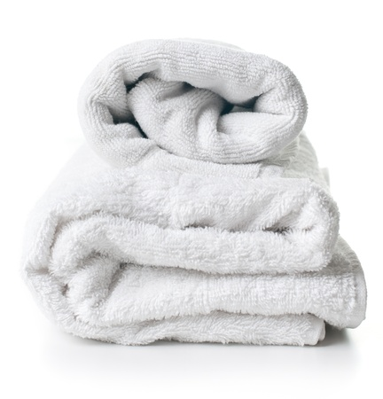 Two clean white terry towels on white background Stock Photo