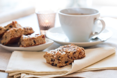 Homemade biscuits and a cup of tea on the table in the morning Stock Photo - 12780738
