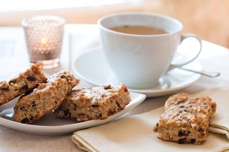 Homemade biscuits and a cup of tea on the table in the morning Stock Photo - 12780750