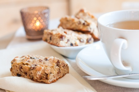 Close-up of home-made bisquits and a cup of tea on the table in the morning Stock Photo - 12780734