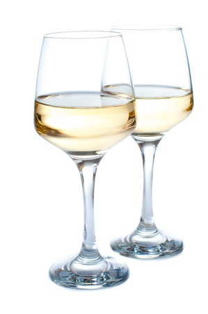 chardonnay: Two glasses of white wine on a white background Stock Photo
