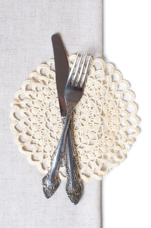 Cutlery and napkins at the edge of the tablecloth photo