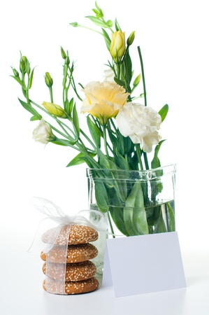 Bouquet of Yellow Eustomas and delicious biscuits on a white background Stock Photo - 12948886