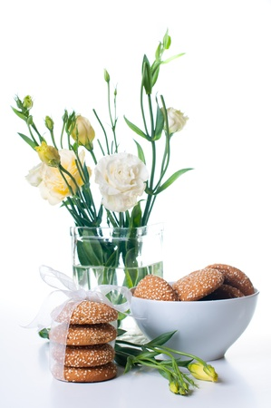 Bouquet of Yellow Eustomas and delicious biscuits on a white background Stock Photo - 12948864