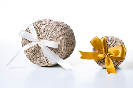 Two wicker box with ribbons of various sizes on a white background photo