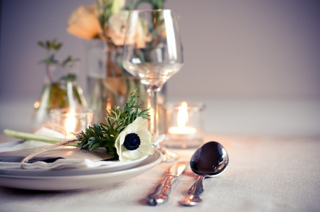 wedding table decor: Holiday table setting with white flowers and candles Stock Photo