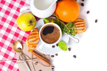 Beautiful delicious breakfast, coffee and pastries on the tablecloth photo