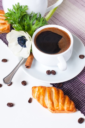Beautiful delicious breakfast, coffee and pastries on the tablecloth Stock Photo - 13109589