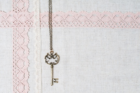 Vintage key, natural linen fabric and exquisite handmade lace photo