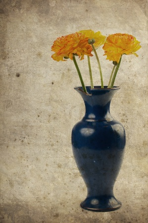 Vintage background with yellow-orange flowers in a vase photo