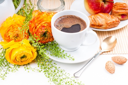 Elegant fresh breakfast: coffee, fruit, pastries, and flowers on a white background Stock Photo - 13153625
