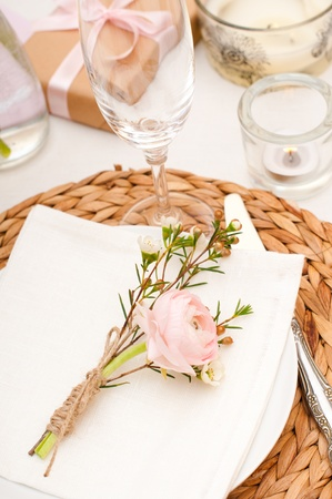Festive table setting with pink flowers and candles photo