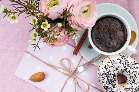 Lovely breakfast in pink colors with coffee, flowers and sweets  photo