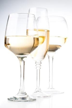 Three different glasses of white wine, close-up photo