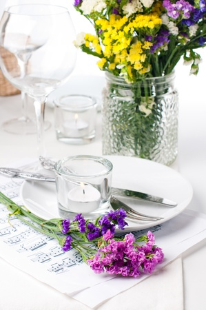 Festive table setting and decoration with fresh flowers photo