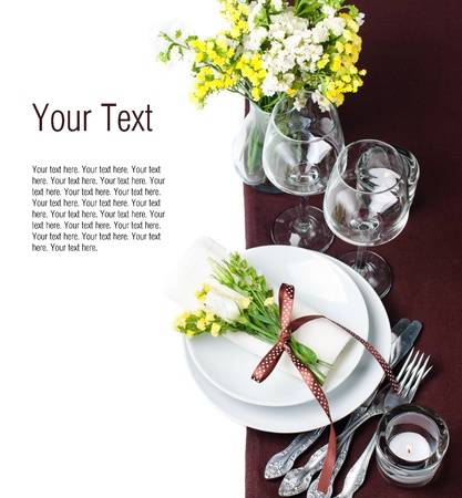 plate setting: Festive table setting and decoration with fresh flowers in brown and yellow