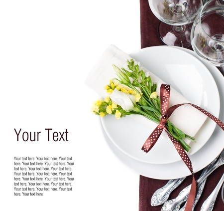 place setting: Festive table setting and decoration with fresh flowers in brown and yellow
