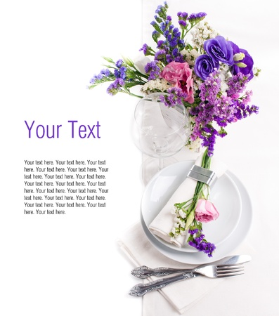 Festive table setting and decoration with colorful fresh flowers photo