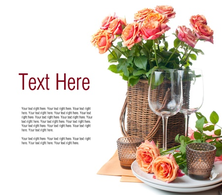 Template with festive table setting with roses and candles in shades of orange on a white background photo