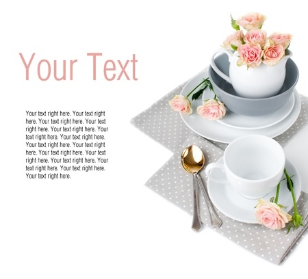 Tableware for tea template with roses and napkins photo