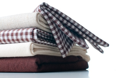 stack of new fabrics in different colors and textures, close-up