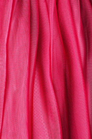 tulle: Texture of flowing wavy pink fabric, close-up Stock Photo