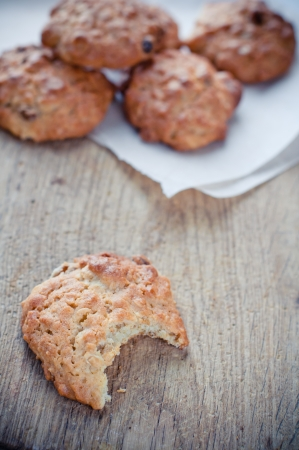 Fresh sweet homemade oatmeal cookies on a wooden board Stock Photo - 15686247