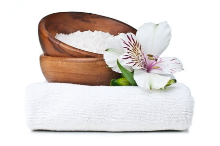 alstroemeria: resources for spa, white towel, aromatic salt and Alstroemeria flower, isolated