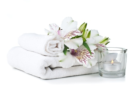 terry: resources for spa, white towel, candle and Alstroemeria flower, isolated