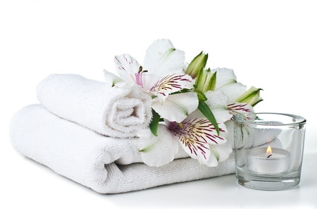 towel  spa  bathroom: resources for spa, white towel, candle and Alstroemeria flower, isolated