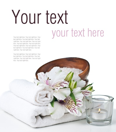 terry: Spa and hygiene concept, white towel, aromatic salt, candles and flower, isolated, ready template Stock Photo