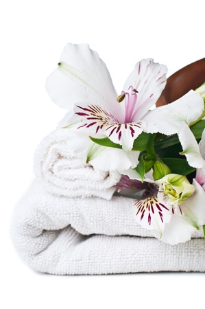 terry: resources for spa, white towel and Alstroemeria flower, isolated Stock Photo