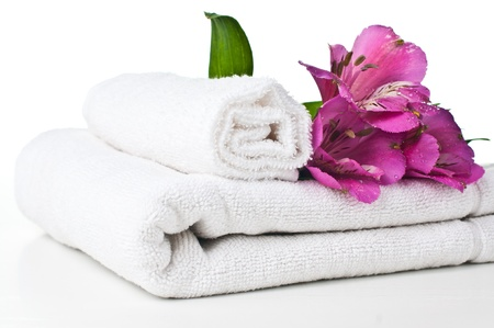 resources for spa, white towel and Alstroemeria flower, isolated Stock Photo