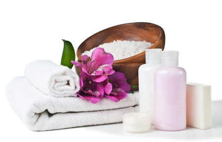 resources for spa, white towel, aromatic salt, cream, soap and pink flower, isolated