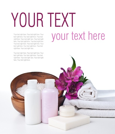 Spa and hygiene concept, white towel, aromatic salt, creams, soaps and flower, isolated, ready template photo