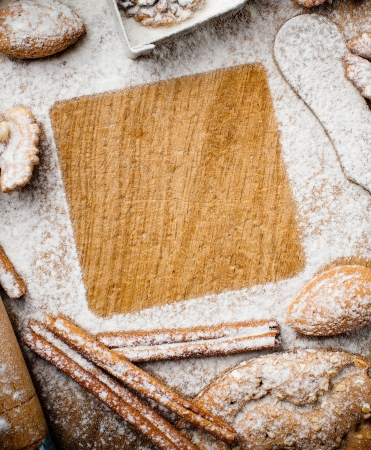 Christmas and holiday baking, cookies, flour, spruce branches and square space for text on a wooden board, ready template Stock Photo - 16512592