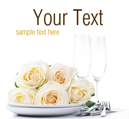 holiday catering: Festive table setting with beige roses, wine glasses, candles, napkins and cutlery, isolated, ready template Stock Photo