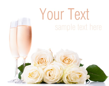 Two glasses of cold champagne and a bouquet of beige roses on a white background, isolated, ready template