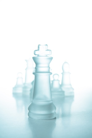 Success and leadership concept, glass chess piece king on a white background isolated. photo