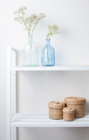 idea comfortable: home interior decoration  the branches in vintage bottles and baskets on white shelves