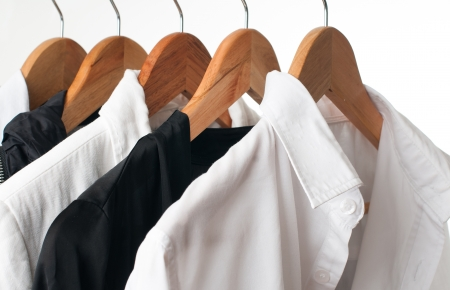 Black and white clothes hanging on a rack in a row, close-up Stock Photo - 18032130