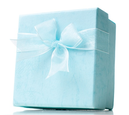 Beautiful blue gift box with a bow, closed on a white background, isolated, close-up photo