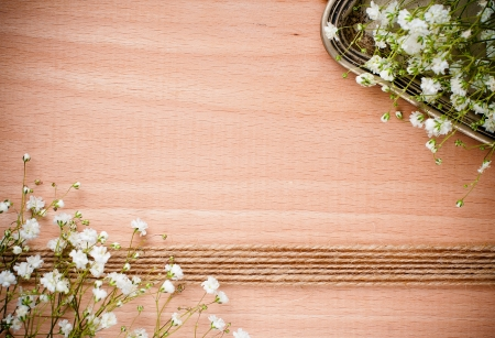 Vintage background with white flowers, antique tray on a wooden board photo