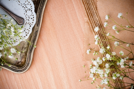 Vintage background with white napkin, flowers and antique tray on a wooden board photo