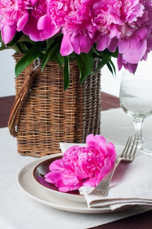 pink brown: Beautiful table setting with pink peonies, vintage cutlery and brown tablecloth.